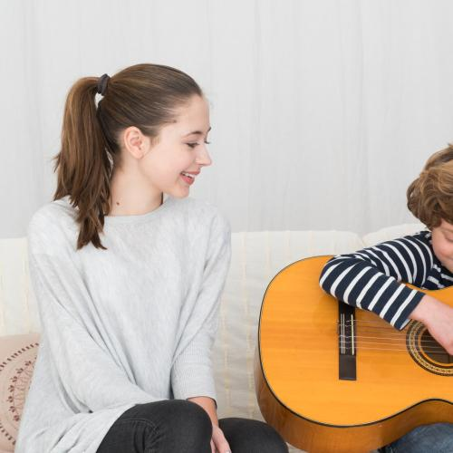 """Brisbane Parents Reveal How They """"Begged & Bribed"""" Their Kids To Keep Playing Music"""